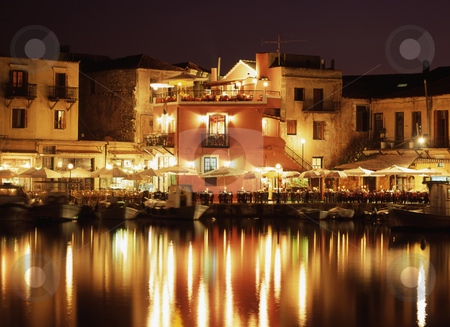 Evening in Crete stock photo, The lights of the Venetian harbour Rethymnon, Crete. by Paul Phillips