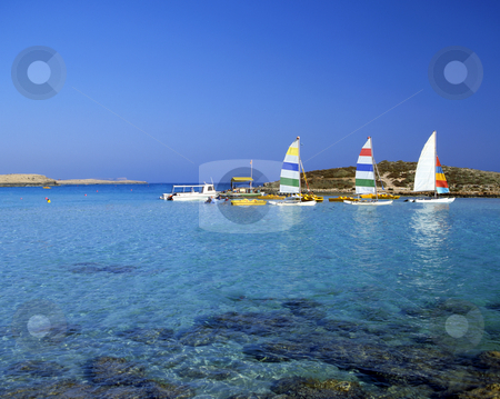Just fun stock photo, Bright pleasure sailboats by rocks in the shallow water of Nissi Beach, Cyprus by Paul Phillips