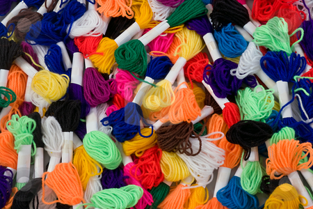 Wool rainbow stock photo, Many coloured samples of wool as a background by Paul Phillips