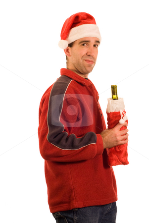 Christmas Wine stock photo, A man wearing a santa hat, holding a bottle of wine, isolated against a white background by Richard Nelson