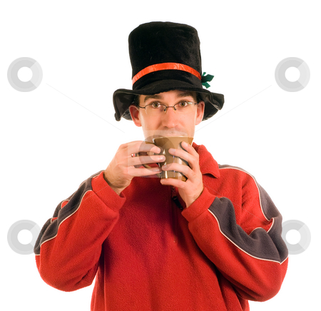 Drinking Hot Cocoa stock photo, A man wearing a top hat drinking hot chocolate by Richard Nelson