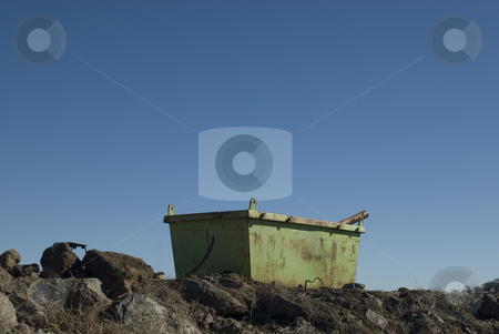 Empty skip stock photo, Rusty green skip on a building site, surrounded by rubble by Stephen Gibson