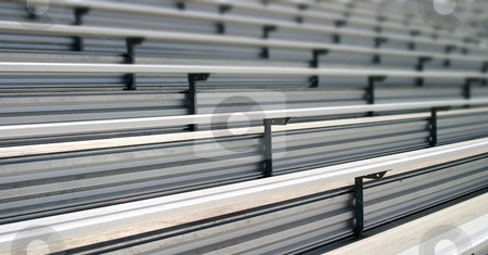 Bleachers stock photo, Bleachers in a stadium or school for the fans by Henrik Lehnerer