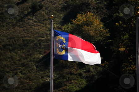 Flag in the wind stock photo, North Carolina flag blowing in the breeze by Tim Markley
