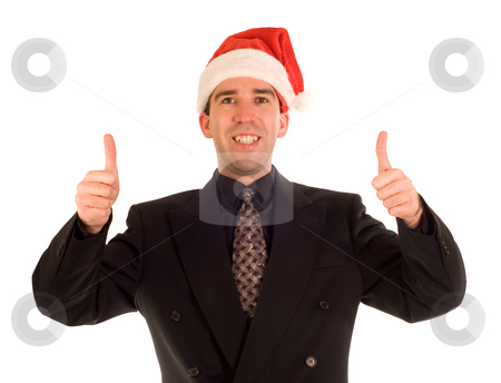 Yuletide Joy stock photo, A young businessman giving two thumbs up while wearing a Christmas cap by Richard Nelson