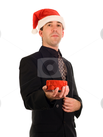 Christmas Gift stock photo, A young businessman holding a Christmas gift by Richard Nelson