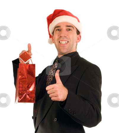 Businessman And His Gift stock photo, A businessman holding his Christmas gift isolated againt a white background by Richard Nelson