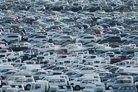 Carpark stock photo, Hundreds of new cars waiting for their owners by Stephen Gibson
