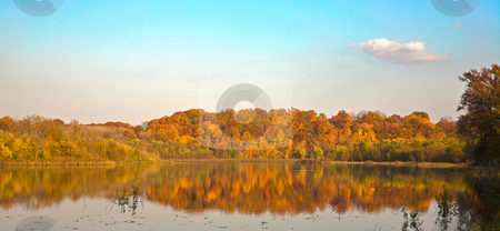 Fall colors on a calm lake stock photo, Fall colors on a calm lake - with beautiful reflections by Mitch Aunger