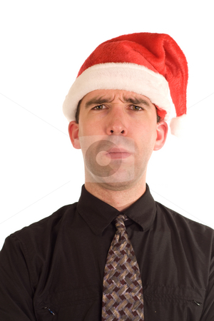 Grumpy Christmas stock photo, A grumpy businessman wearing a Christmas cap by Richard Nelson