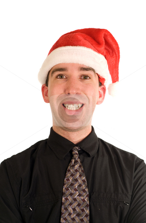 Merry Christmas stock photo, A happy businessman wearing a Christmas cap, smiling by Richard Nelson