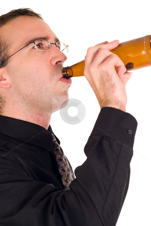 Alcoholic stock photo, A young man drinking the final drops from a bottle of beer by Richard Nelson