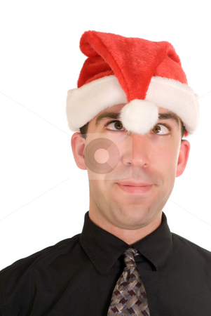 Goofy Christmas stock photo, A young businessman wearing a santa hat and acting goofy by Richard Nelson
