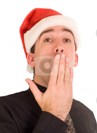 Tired Christmas Businessman stock photo, A businessman yawning at the thought of working on Christmas by Richard Nelson