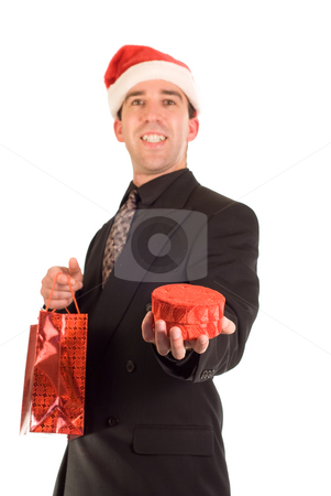 Businessman Holding Gift stock photo, A businessman holding out a gift as an offering by Richard Nelson