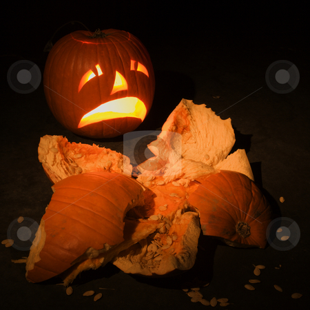 Smashed pumpkin. stock photo, Upset jack-o'-lantern looking at smashed pumpkin. by Iofoto Images