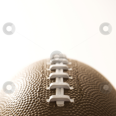 Football close up. stock photo, Close-up of American football on white background. by Iofoto Images