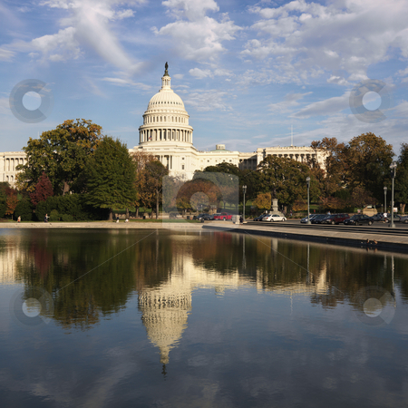 Capitol Building, Washington DC. stock photo, Capitol Building and reflection in water in Washington, DC, USA. by Iofoto Images