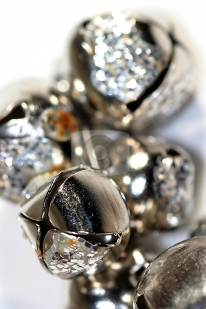 Bells stock photo, Silver shiny bells close up on white background by Henrik Lehnerer