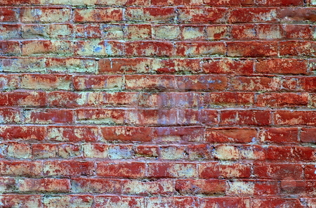 Brick Wall stock photo, Red bricks wall with an regular pattern as a background by Henrik Lehnerer