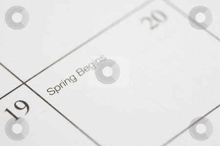 Spring Begins. stock photo, Close up of calendar displaying the beginning of spring. by Iofoto Images