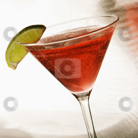 Still life of martini. stock photo, Still life of martini mixed drink with raspberry fruit agaisnt white background. by Iofoto Images