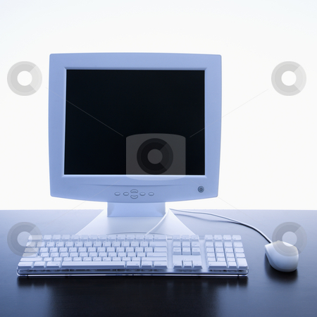 Computer hardware. stock photo, Still life of computer monitor, keyboard and mouse. by Iofoto Images