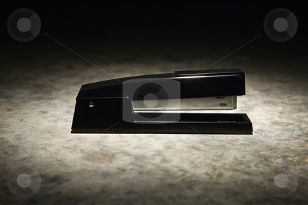 Stapler. stock photo, Black stapler with black vignette. by Iofoto Images