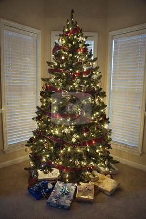 Christmas tree. stock photo, Christmas presents under decorated Christmas tree. by Iofoto Images