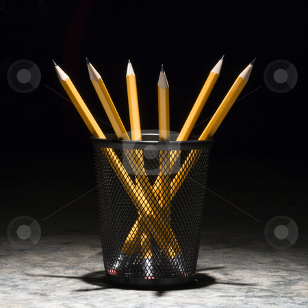 Pencils in holder. stock photo, Group of pencils in a wire mesh pencil holder. by Iofoto Images