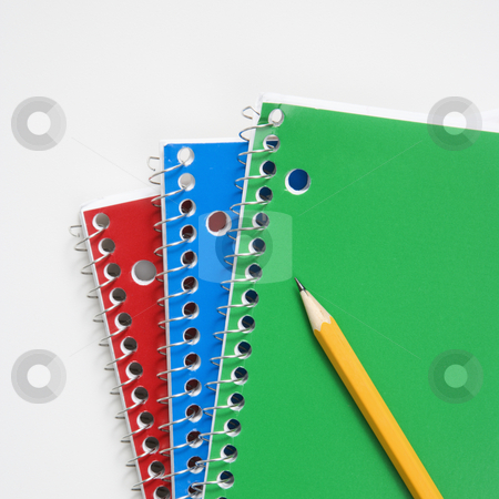 Pencil on notebooks stock photo, Close up of pencil on top of three spiral bound notebooks. by Iofoto Images
