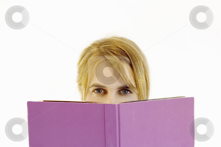 I Like to Read stock photo, A young woman looking over the top of an open book by Lee Torrens