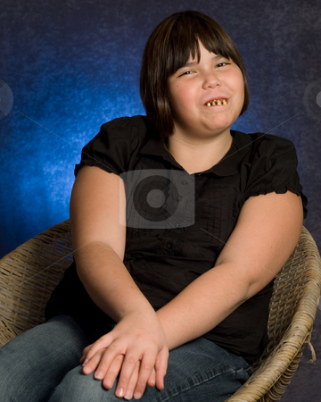 Adorable Girl stock photo, An adorable looking girl wearing some ugly rotten teeth, while getting her portrait done by Richard Nelson