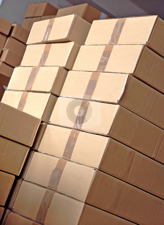 Boxes piles stock photo, Piles of paper boxes with goods in storage by Julija Sapic
