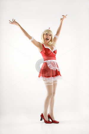 Happy woman. stock photo, Blonde Caucasian young woman in french maid oufit. by Iofoto Images