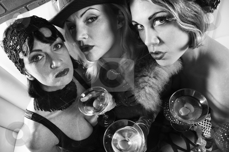 Retro women with martinis. stock photo, Three retro prime adult Caucasian females out on the town. by Iofoto Images
