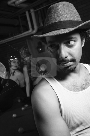 Man dressed like retro gangster. stock photo, Caucasian prime adult retro male being checked out behind his back by two Caucasian prime adult retro females. by Iofoto Images