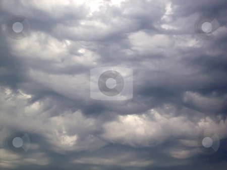 Mammatus Clouds stock photo, Mammatus clouds (also called mammatocumulus)--sagging, rounded, pouch-like formations that appear below the base of a cloud. by Kathy Piper