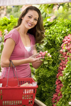 Woman shoppping in produce section  stock photo, Woman shopping in produce section of supermarket by Monkey Business Images