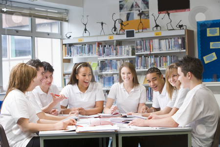 Schoolchildren studying in school library stock photo,  by Monkey Business Images