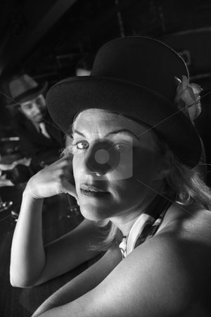 Retro woman at bar. stock photo, Caucasian prime adult retro female sitting at bar looking at viewer. by Iofoto Images