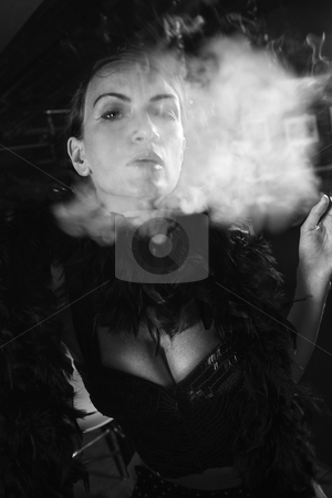 Retro female smoking. stock photo, Caucasian prime adult female smoking looking at viewer. by Iofoto Images