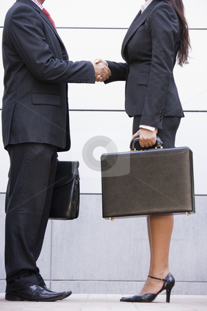 Cropped image of business meeting outside office stock photo, Cropped image of business meeting outside modern office by Monkey Business Images