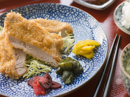 Tonkatsu Plated with Rice Miso Soup and Pickles stock photo, Plate of Tonkatsu Pork with Rice Miso Soup and Pickles by Monkey Business Images