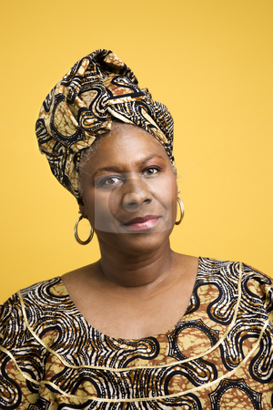 Woman dressed in African costume. stock photo, African American mature adult female dressed in African costume. by Iofoto Images