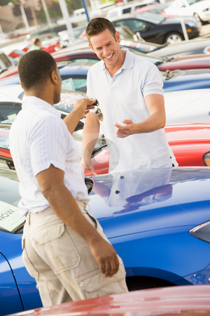 Man collecting new car stock photo, Man collecting new car from dealer by Monkey Business Images