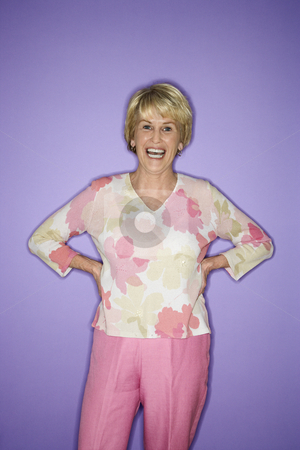 Woman standing and smiling. stock photo, Caucasian mature adult female standing and smiling. by Iofoto Images