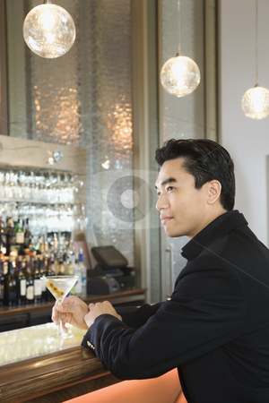 Man sitting at bar. stock photo, Prime adult Asian male sitting at bar. by Iofoto Images