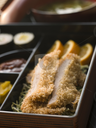 Tonkatsu Box and Miso Soup with Pickles and Sushi stock photo, Close up of Tonkatsu Box and Miso Soup with Pickles and Sushi by Monkey Business Images