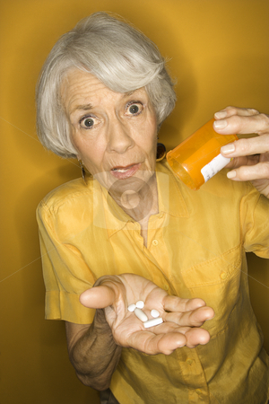 Woman with medication. stock photo, Caucasian mature adult female with medication. by Iofoto Images